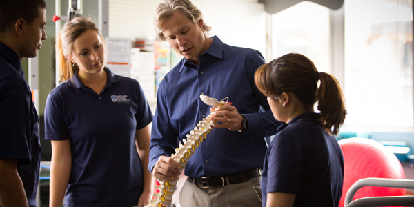 Students Observing Spine in Classroom